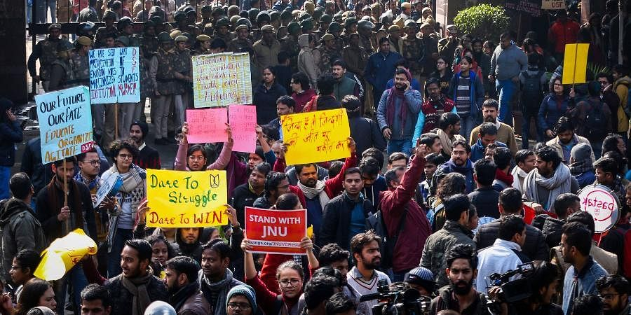 JNU students gather at the entrance gate of the Jawaharlal Nehru University before leaving for their protest march from Mandi House to HRD Ministry, demanding removal of the university vice-chancellor, in New Delhi.