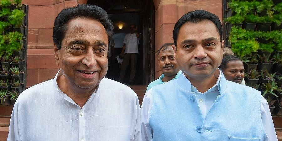 Madhya Pradesh CM Kamal Nath (L) with his son and MP Nakul Nath