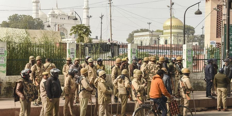 olice personnel deployed outside the historic Tiley Wali Masjid ahead of Friday prayers in view of protests against CAA and NRC in Lucknow