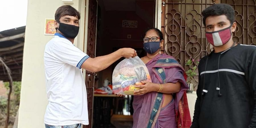Dhilli Rao and Rupesh Kumar delivering groceries to people in Mandasa