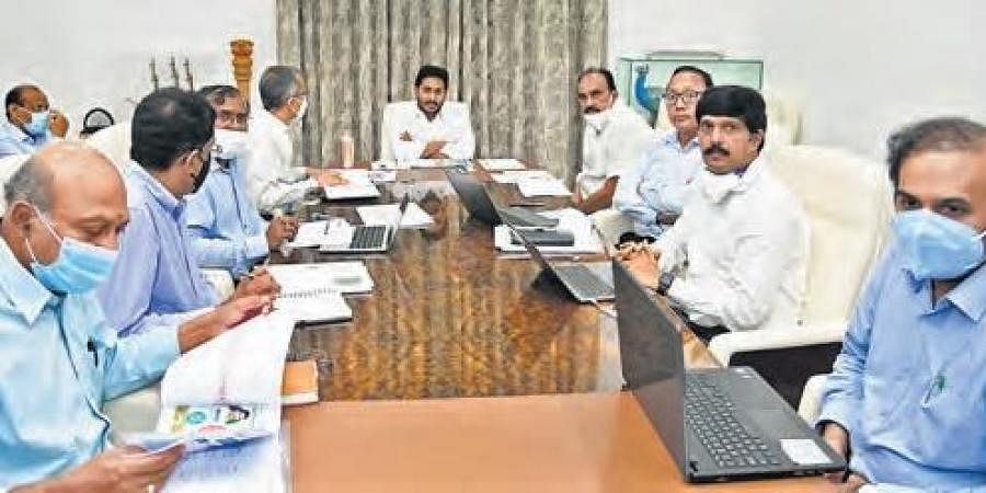 Chief Minister YS Jagan Mohan Reddy holds a review meeting on supply of 9-hour free power to the farm sector at his camp office in Tadepalli on Monday.