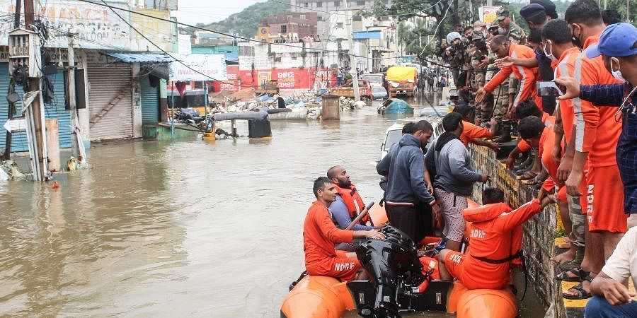 NDRF teams are also actively involved in relief operations and have so far rescued 72 people from flood-hit Meerpet area on the city outskirts. (Photo | Vinay Madapu, EPS)