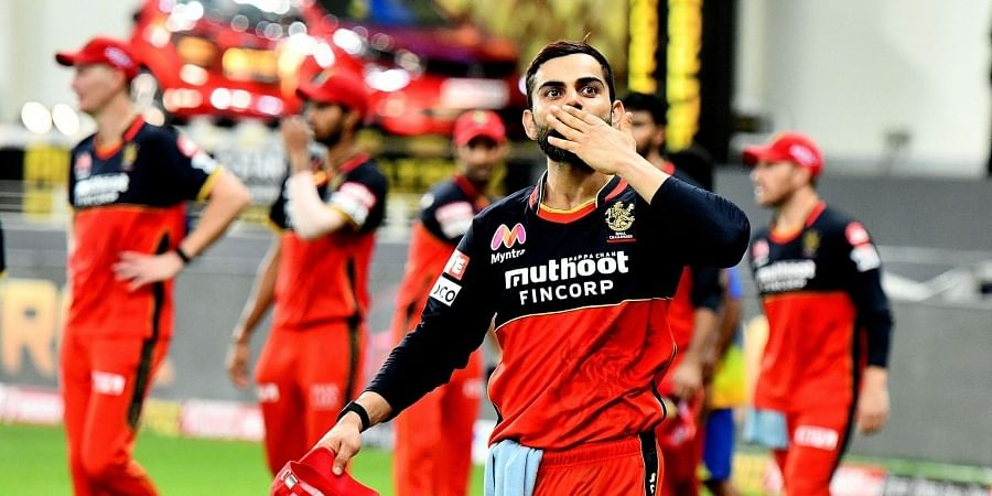 Virat Kohli celebrates the victory over CSK by blowing a kiss to his fans in the stands. (Photo | IPL)