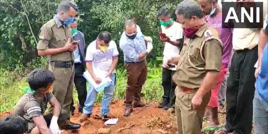 Body of an 80-year-old man who allegedly buried alive by his kin over suspicion of practising witchcraft in West Garo Hills, was exhumed for investigation