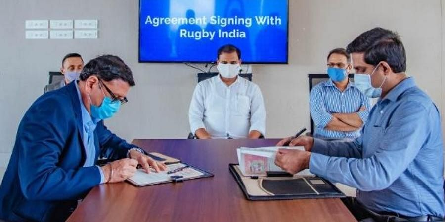 Sports Director R Vineel Krishna and president of IRFU Maneck Unwala signing the agreement on Tuesday.
