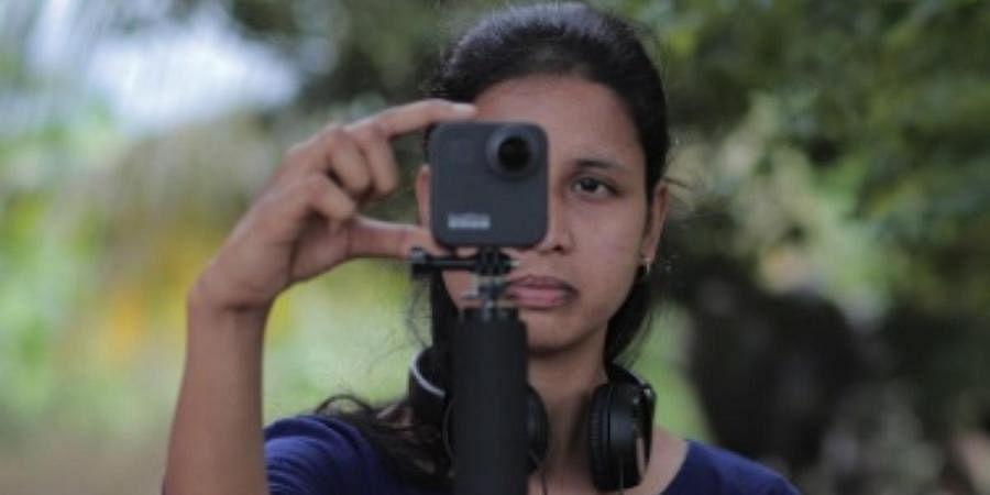 Ashwini Doddalingannavar teaching students in rural areas with digital equipment