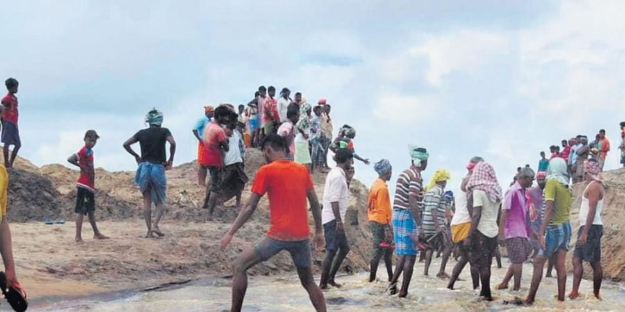 Villagers digging the mouth of Rushikulya river near Potagarh on Thursday.