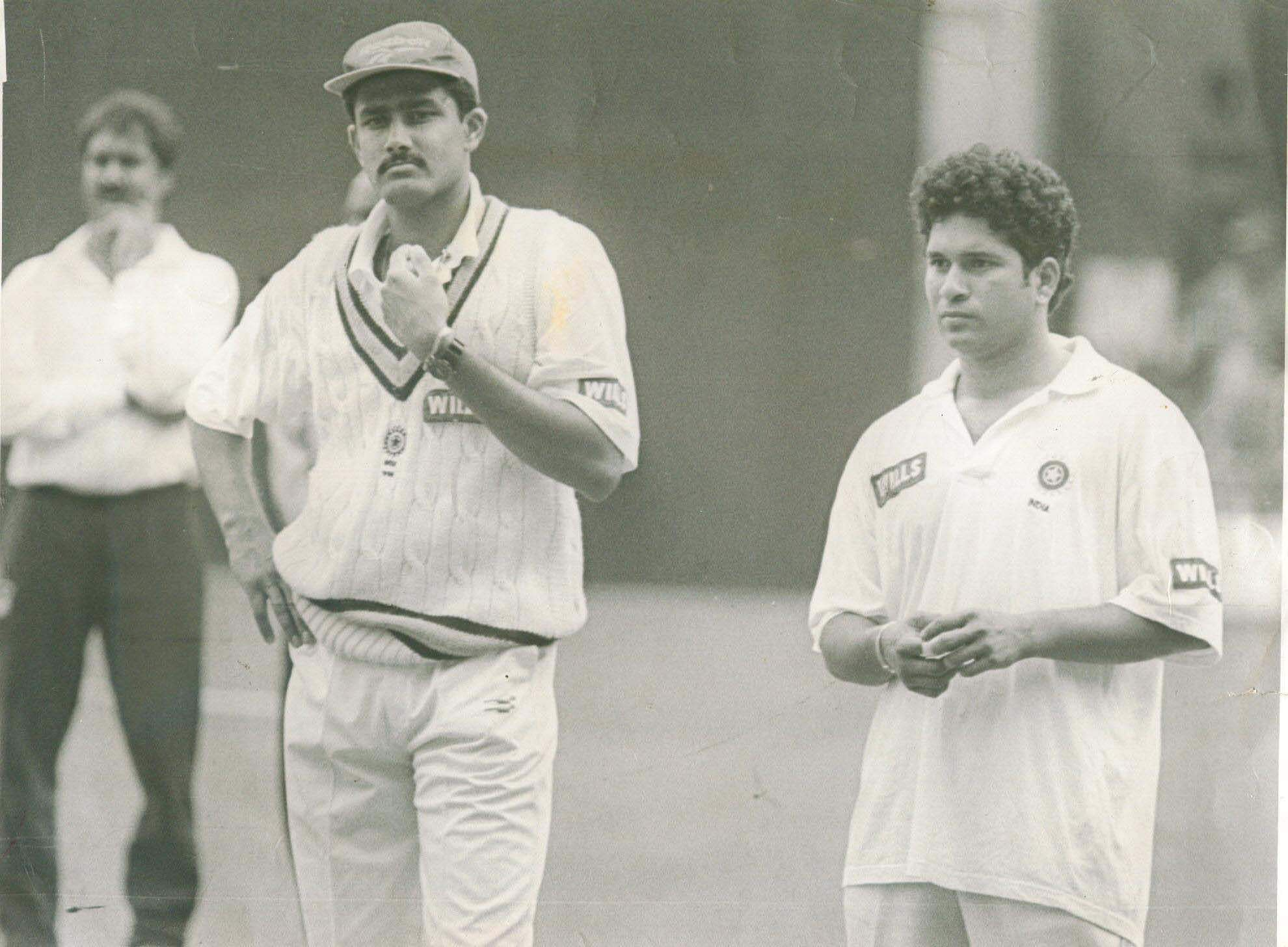 Former Indian cricketers Anil Kumble (L) and Sachin Tendulkar.