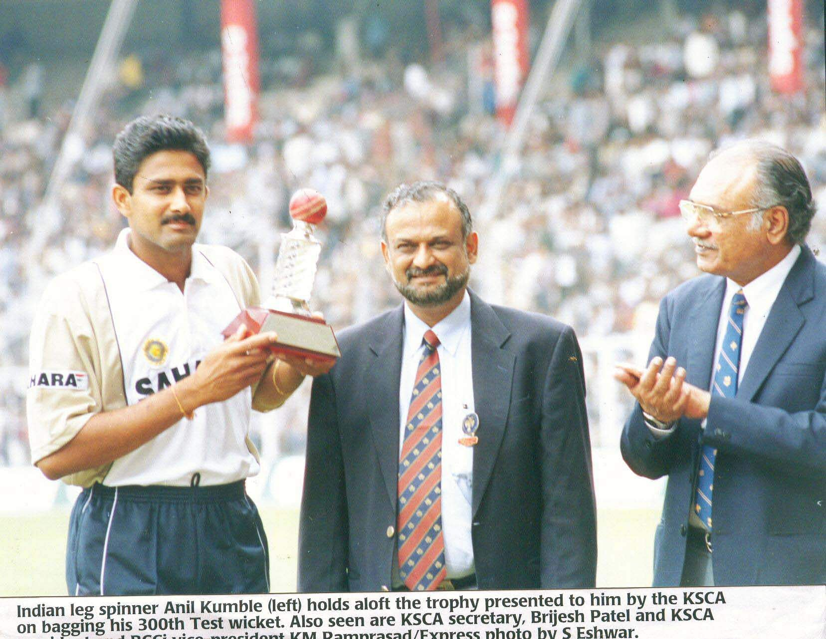 Indian Leg Spinner Anil Kumble (Left) holds aloft the trophy presented to him by the KSCA on bagging his 300th Test Wicket. Also seen are the KSCA Secretary, Brijesh Patel and KSCA President and BCCI vice-president KM Ram Prasad.