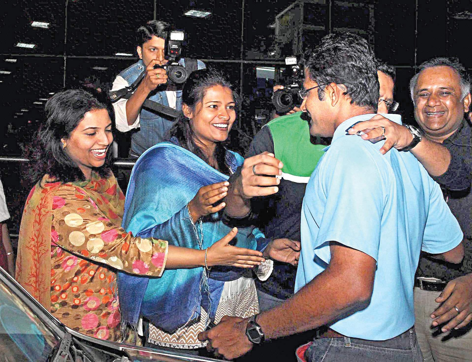 Family members welcome then Indian test cricket team Captain Anil Kumble at Bangalore airport after he returned from an Australian tour.