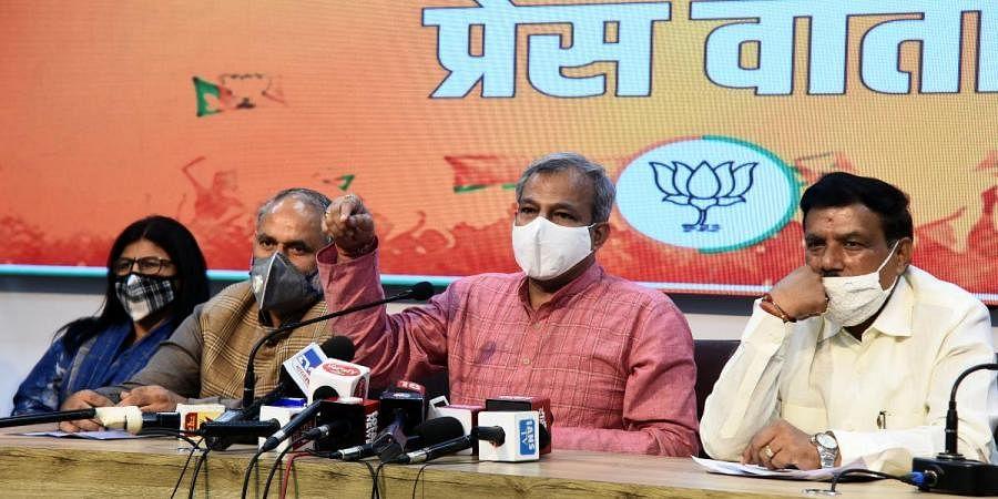 Delhi BJP president Adesh Gupta along with three MCD Mayors at a press conference