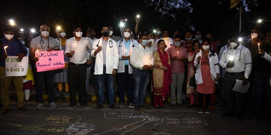Resident doctors of Hindu Rao Hospital and Kasturba Hospital protest against non-payment of salaries in New Delhi