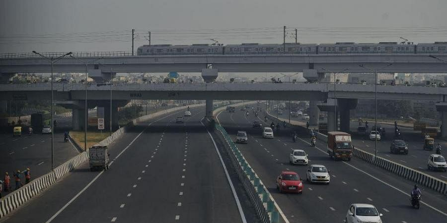 Metro train running on track during the smoggy morning as the air quality dips, in New Delhi