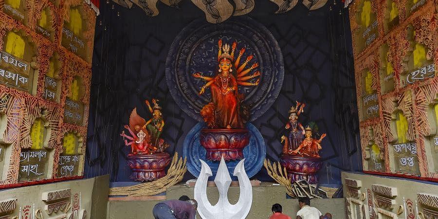 An idol of Goddess Durga at a community puja pandal ahead of the Durga Puja festival, in Kolkata