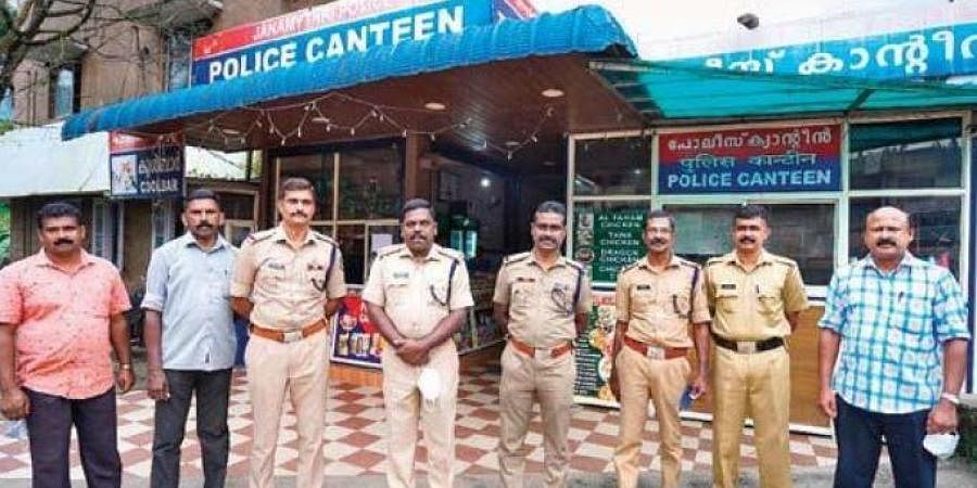 Officers of the Adimali Janamaithri police station in front of the police canteen