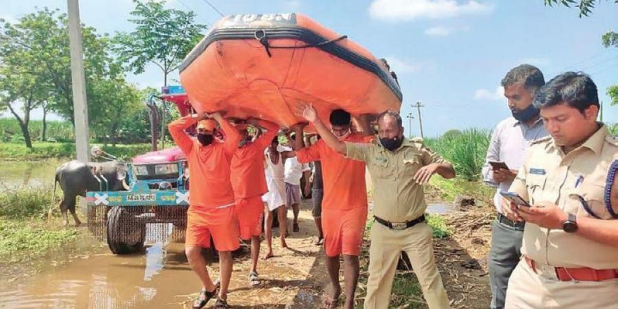 NDRF personnel get ready for flood relief works in Vijayapura on Saturday