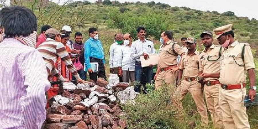 Karnataka and Andhra Pradesh officials, with a Survey of India team, inspect the inter-state border in the Ballari reserve forest area on Saturday