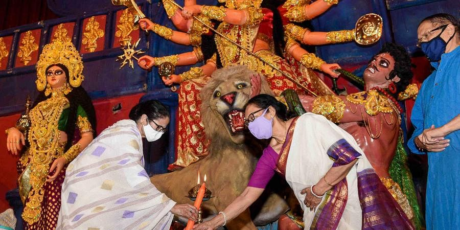 West Bengal CM Mamata Banerjee inaugurates a Durga Puja in Kolkata. (Photo| PTI)