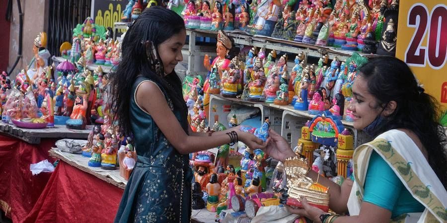 Ahead of the Navarathri festival sale of idols have begun in the city. A girl buying a Krishna idol from a shop at East Fort Thiruvananthapuram on Saturday.