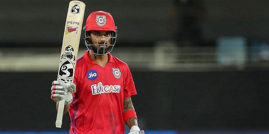 Kings XI Punjab player KL Rahul raises his bat after scoring fifty runs during theirIPL T20match against Mumbai Indians at Dubai International Cricket Stadium.