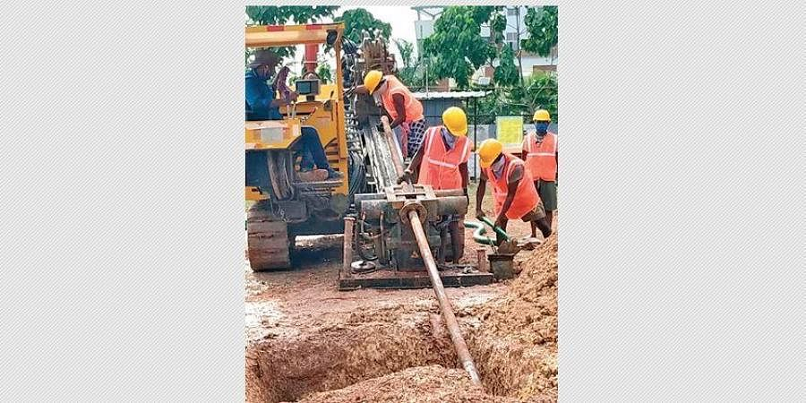 Workers laying a pipeline for  the city gas supply project