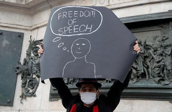 A demonstrator holds a placard on the Republique square during a demonstration in Paris.