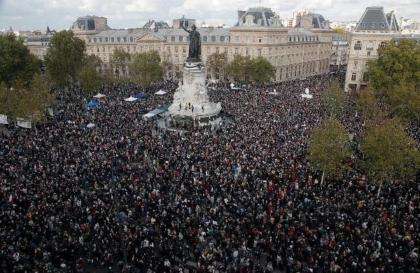 Hundreds of people gather on Republique square during a demonstration in Paris.