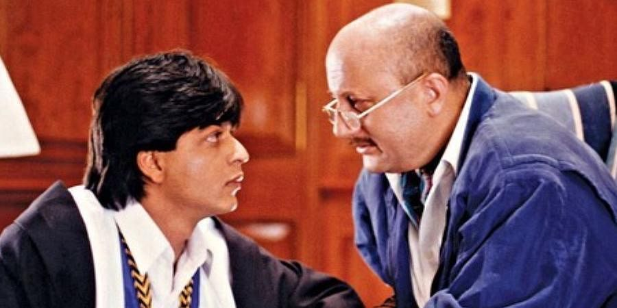 Bollywood actors Shah Rukh Khan (L) and Anupam Kher in 'Dilwale Dulhania Le Jayenge'.