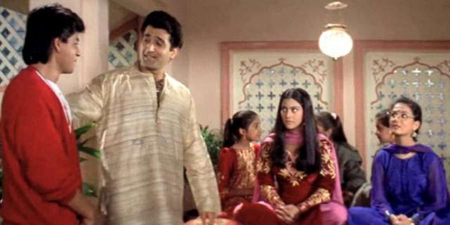 Bollywood actors Shah Rukh Khan (L) and Parmeet Sethi in 'Dilwale Dulhania Le Jayenge'.