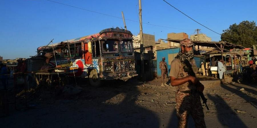 Pakistani rangers stand guard near the site of a bomb blast in Karachi. (Photo| AFP)
