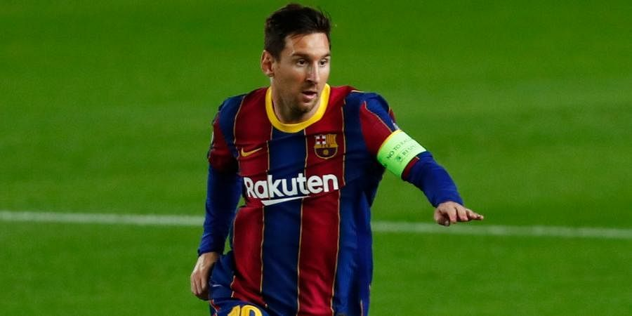 Barcelona striker Lionel Messi controls the ball during the Champions League group G soccer match against Ferencvaros at the Camp Nou stadium.