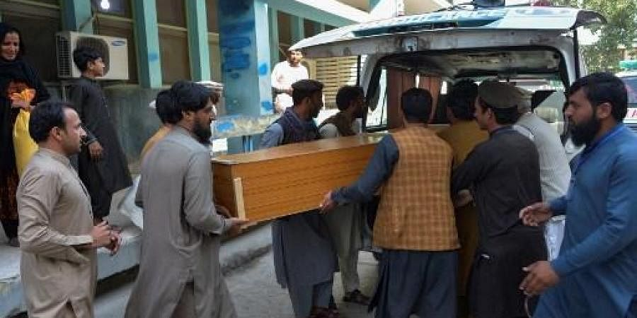Relatives carry the coffin of a victim, who was killed in a stampede, outside a mortuary in Jalalabad on October 21, 2020. (Photo | AFP)