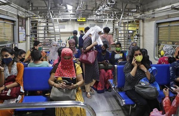 Women passengers travel on a local train in Mumbai, India, Wednesday, Oct. 21, 2020. (Photo | AP)