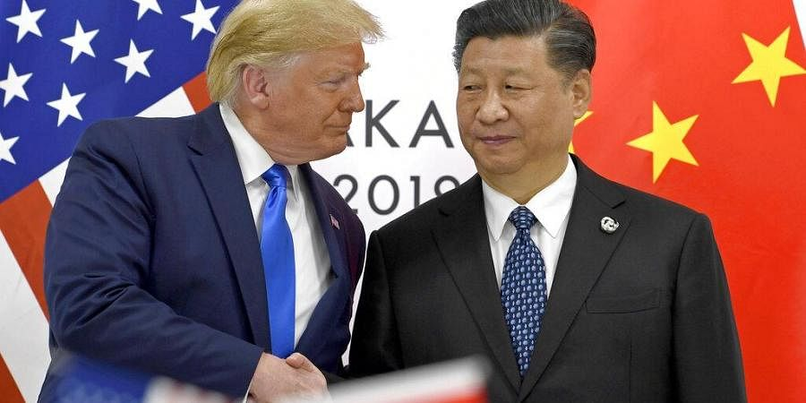 U.S. President Donald Trump, left, shakes hands with Chinese President Xi Jinping during a meeting
