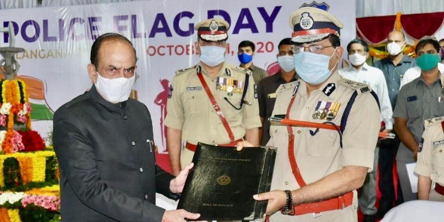 Telangana home minister Mohammed Mahmood Ali (L) and DGP M Mahendar Reddy