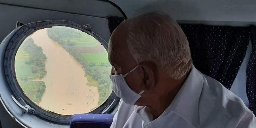 CM B S Yediyurappa doing an aerial survey of flood-hit areas in North Karnataka on Tuesday. (Photo   EPS)