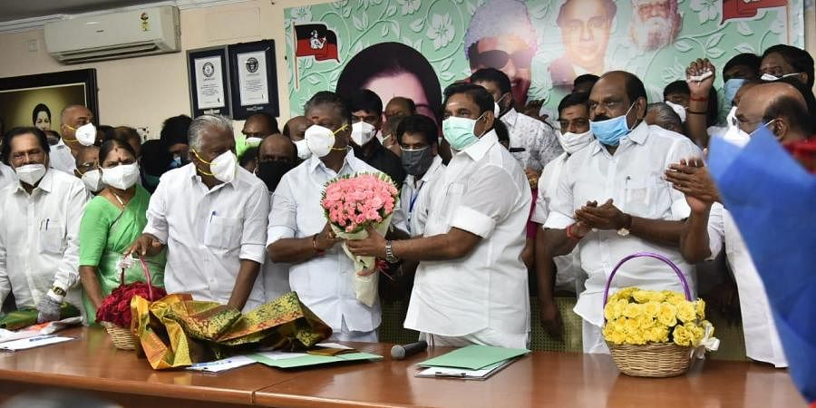 AIADMK co-ordinator O Panneerselvam hand a flower bouquet to CM Palaniswami after announcing the latter as the party's CM candidate. (Photo   EPS/P Jawahar)