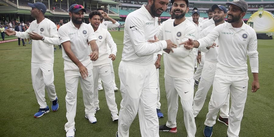 India's cricket team celebrate their series win over Australia after play was called off on day 5 of their cricket test match in Sydney, Monday, Jan. 7, 2019. | AP