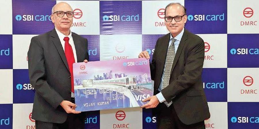DMRC MD Mangu Singh (L) with SBI Card MD & CEO Ashwini Kumar Tewari during the launch of Delhi Metro SBI Card