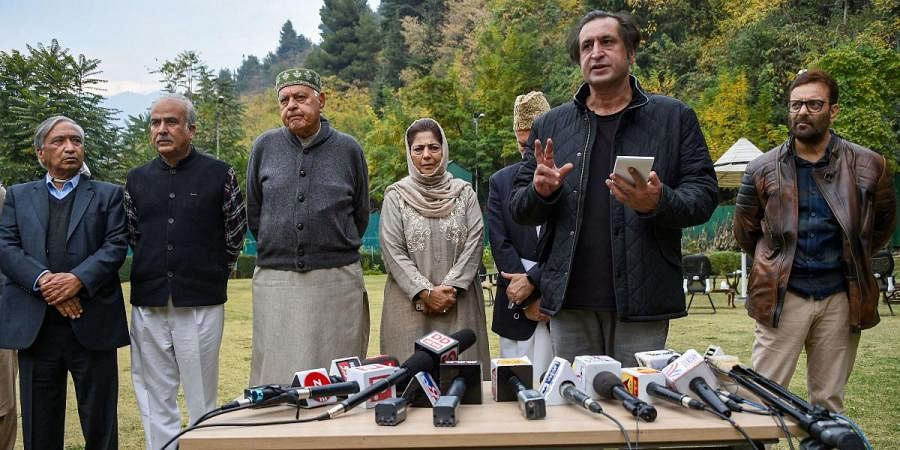 Srinagar MP and National Conference chief Farooq Abdullah along with PDP chief and former CM Mehbooba Mufti and other leaders speak to the media