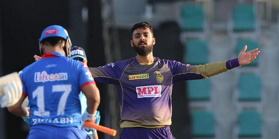 Varun Chakaravarthy of Kolkata Knight Riders celebrates the wicket of Rishabh Pant of Delhi Capitals.
