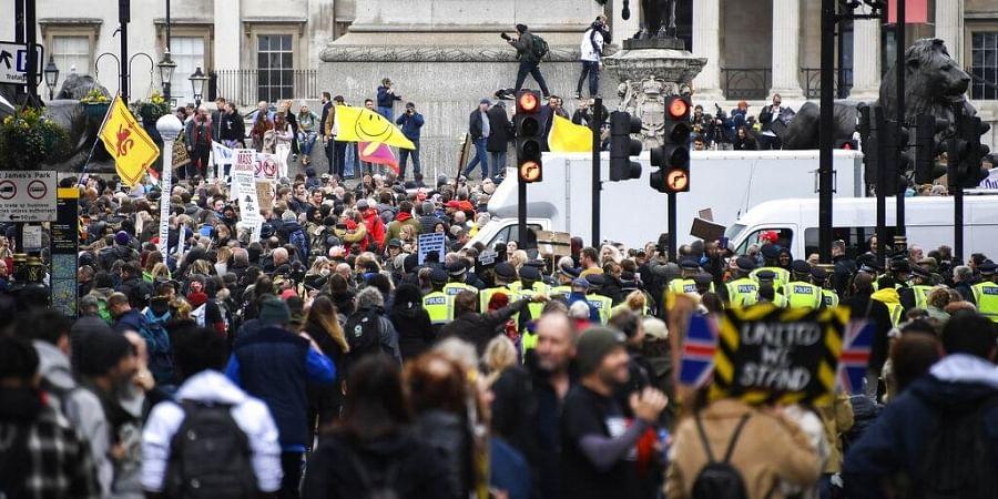 Demonstrators gather in Trafalgar Square, during a coronavirus anti-lockdown protest, in London.