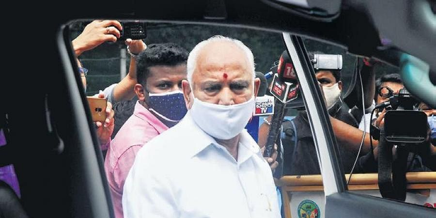 Chief Minister B S Yediyurappa leaves his office in Bengaluru on Saturday | express