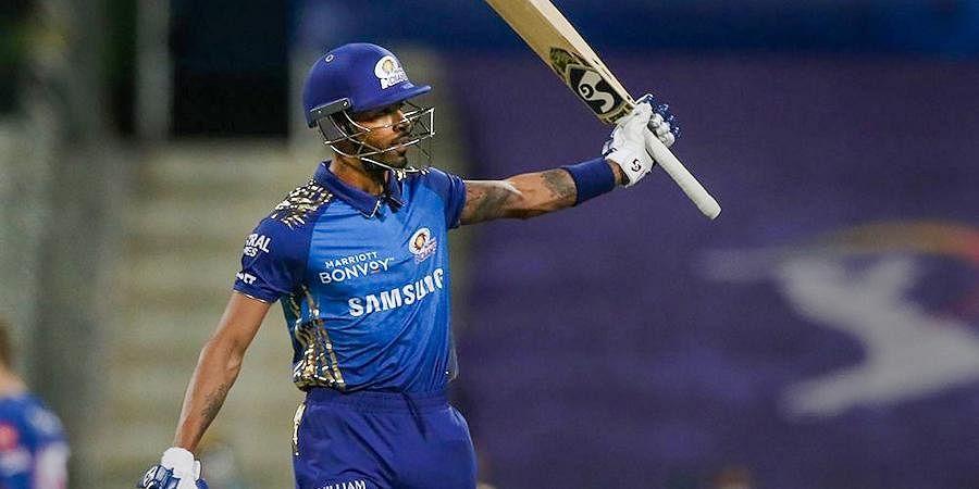 Hardik Pandya of Mumbai Indians raises his bat during IPL match against Rajasthan Royals at the Sheikh Zayed Stadium.