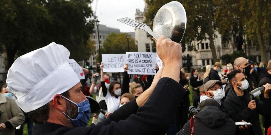 Hospitality workers protest in Parliament Square in London.