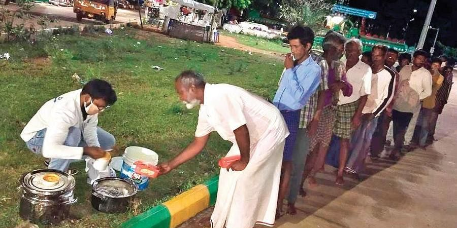 A member of Hands on Foundation distributing food to needy in Nellore.