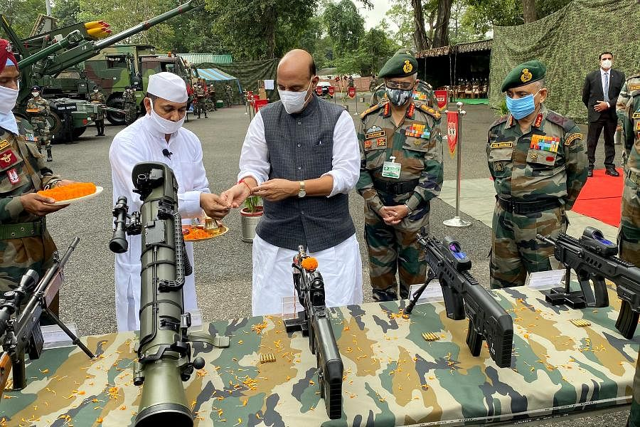 Defence Minister Rajath Singh performs 'Shastra Puja' on the occasion of Dussehra festival at the Sukna Army Camp in Darjeeling