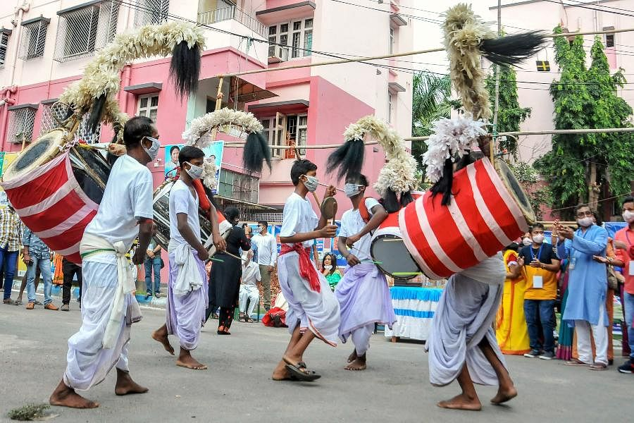 'Dhakis' or traditional drummers perform on Maha Navami during Durga Puja in Kolkata