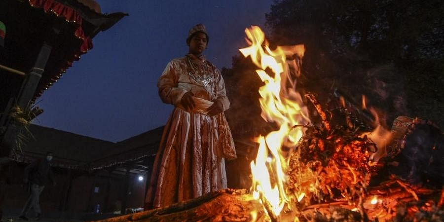 A Hindu priest stands in front of a fire at the Baramahini Temple during the tenth day of Dashain festival in Nepal. (Photo  AFP)