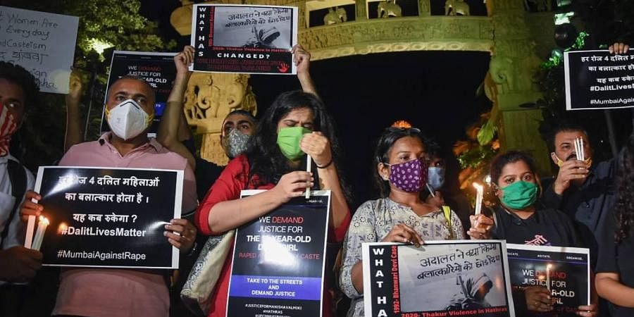 AISF activists hold placards and light candles demanding justice for the Hathras gang-rape victim.